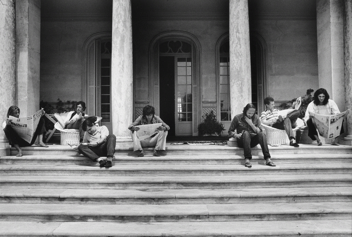 The Rolling Stones Reading Newspapers on the Steps, Nellcôte, France, 1971
