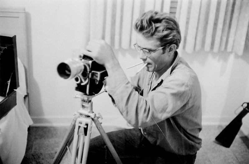 James Dean Working with Camera in Hotel Room While Making Giant, TX, 1955