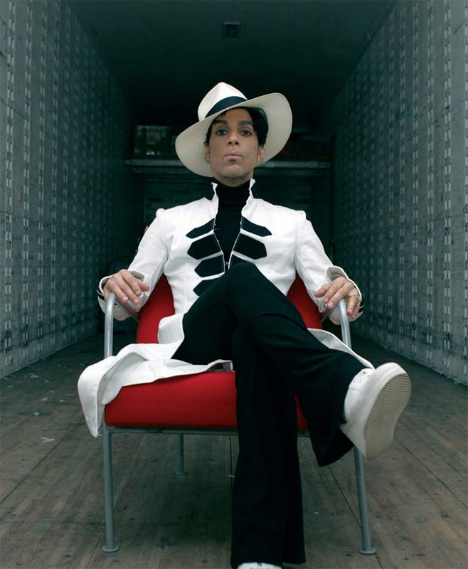 Prince Portrait in White Suit Seated in Trailer, 2004