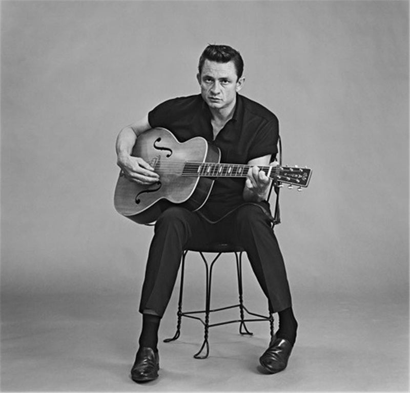 Johnny Cash Seated with Guitar, Photo Studio, Los Angeles, CA, April 3, 1962