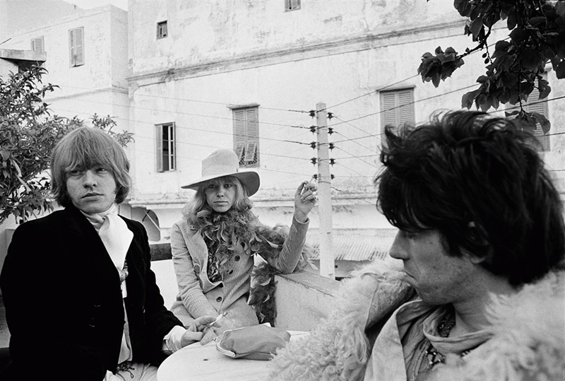 Brian Jones, Anita Pallenberg, and Keith Richards at a Cafe, Marrakesh, Morocco, 1967