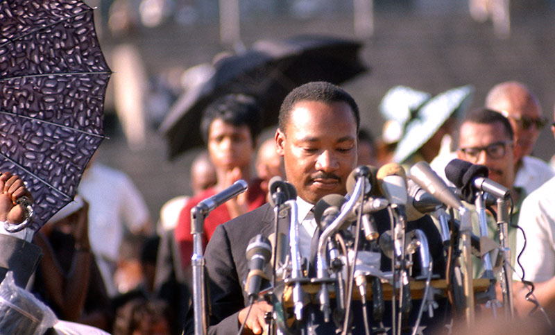 Martin Luther King Jr., Speaking at Rally, Soldier Field, Chicago, 1966 (Umbrellas)