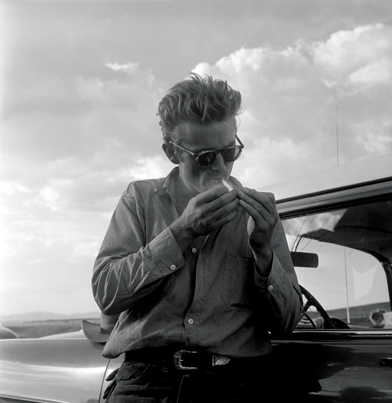 James Dean Lighting a Cigarette, While Making Giant, Marfa, TX, 1955