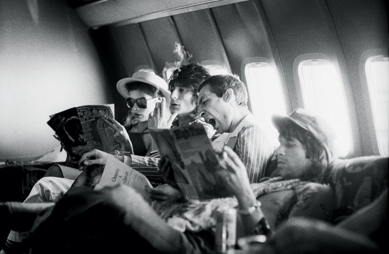 The Rolling Stones Reading Newspapers on Their Plane, 1975