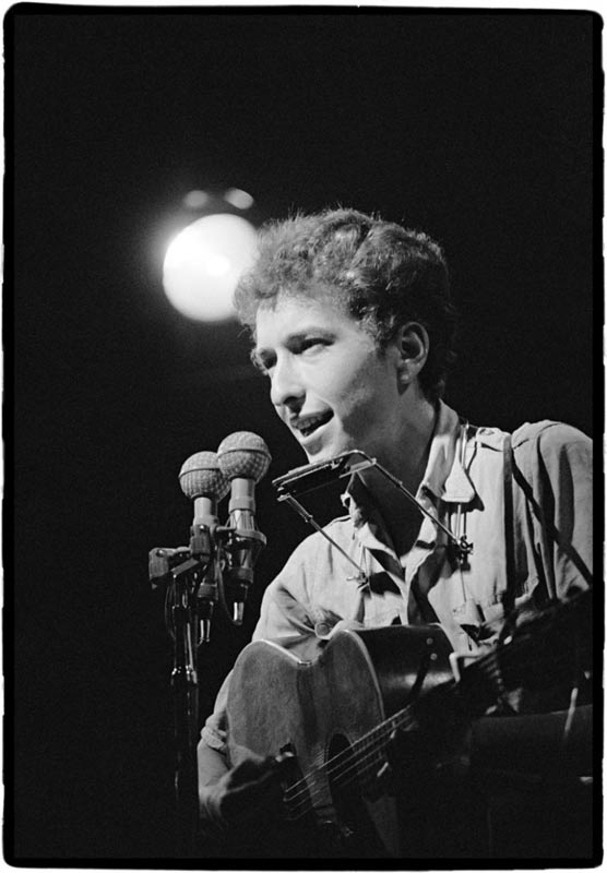 Bob Dylan Singing into Mics (spot behind), Newport Folk Festival, 1963