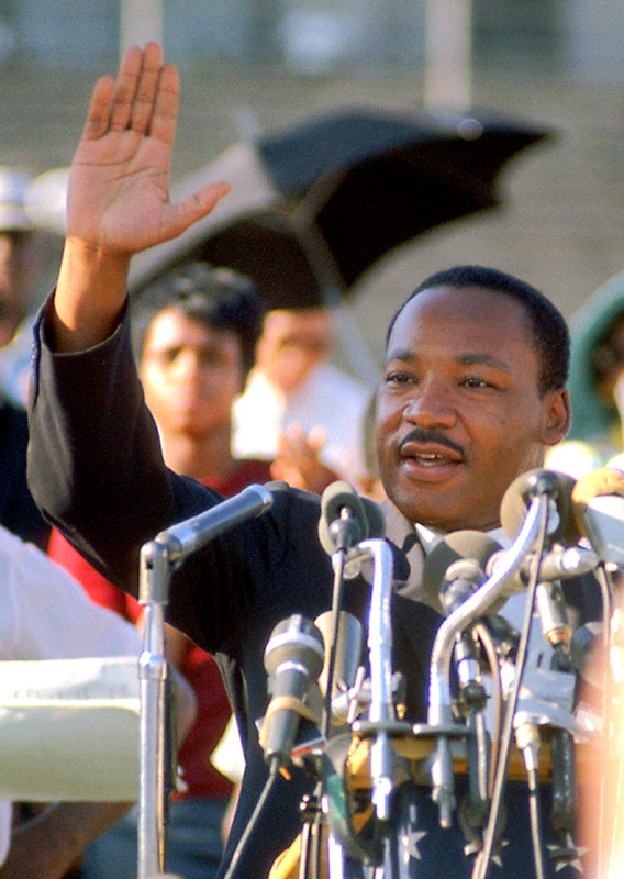 Martin Luther King Jr., Waving From Podium, Soldier Field, Chicago, 1966