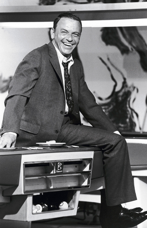 Frank Sinatra Sitting on a Pool Table