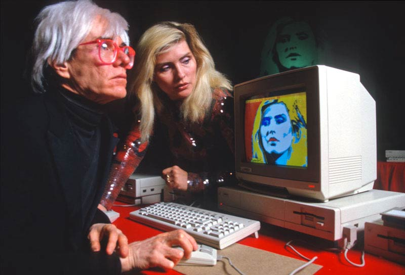Andy Warhol and Debbie Harry Demonstrating the Amiga Computer, NYC, 1985