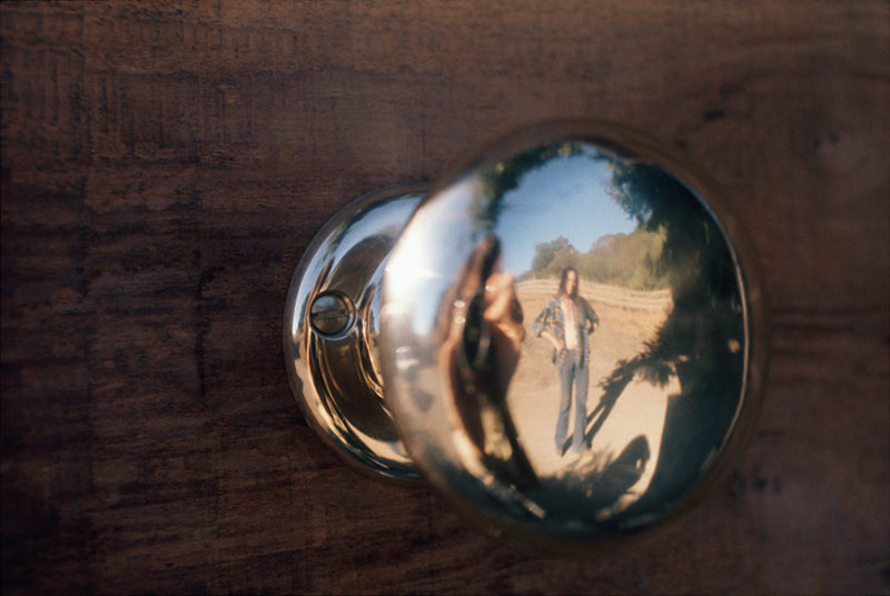 Neil Young Reflection in a Doorknob, Broken Arrow Ranch, CA, 1971