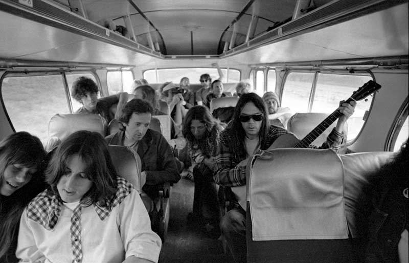 Neil Young, Cameron Crowe & The Eagles on a Tour Bus, CA, 1974