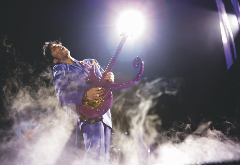 Prince Onstage in Smoke (Leaning Back) SLC 2004