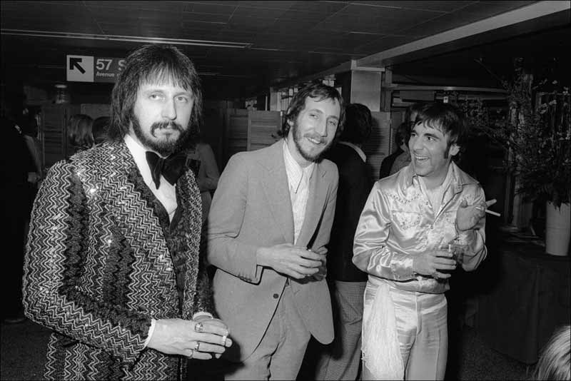 John Entwistle, Pete Townshend and Keith Moon of The Who at a party for the film Tommy, NYC, 1975