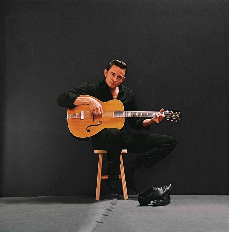 Johnny Cash Seated with Shoes Off, Photo Studio, Los Angeles, CA, 1962