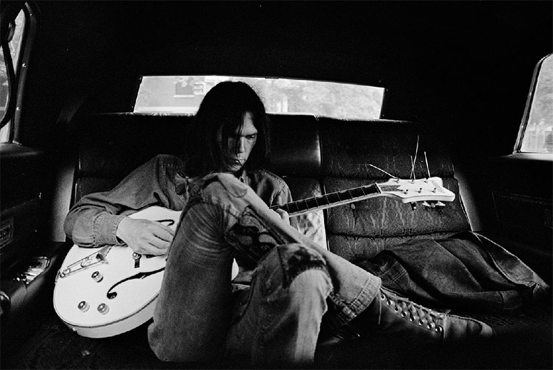 Neil Young in Limo with White Falcon, NYC, 1970