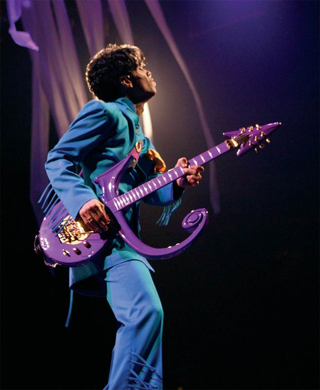 Prince Onstage Playing Purple Guitar (Looking Away), Toronto, 2004