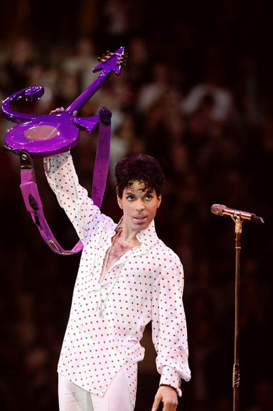 Prince Onstage in Polka Dots Holding Purple Guitar Up, MSG, 2004