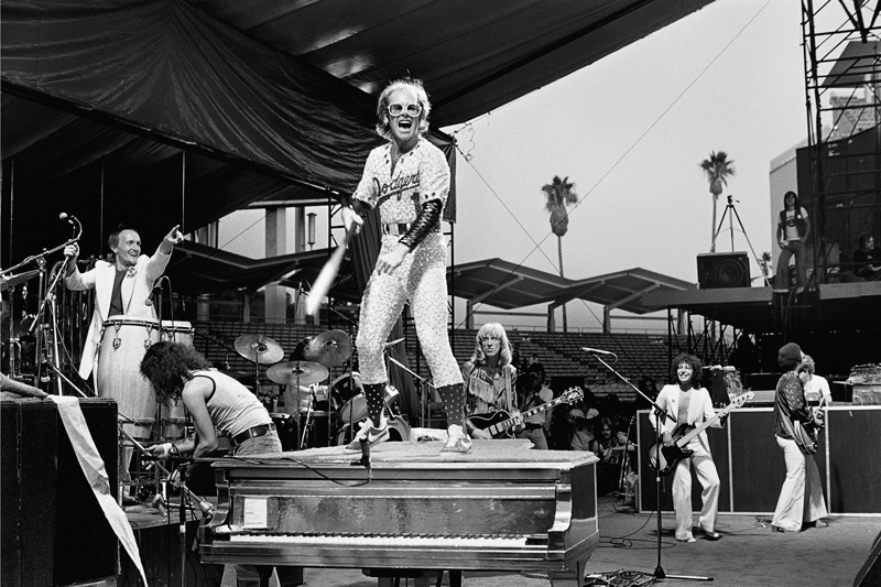 Elton John Standing on Piano, Dodger Stadium, 1975