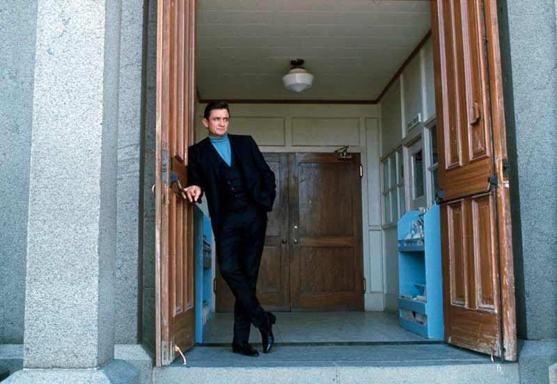 Johnny Cash Outside Greystone Chapel in Doorway - [Color], Folsom, CA 1968
