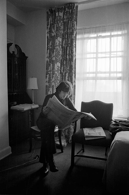 Graham Nash Reading a Newspaper, NYC, 1970