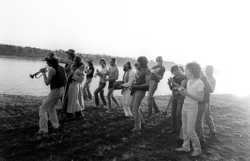 Bob Dylan Leading Music Troupe Across the Grass, Newport, RI, 1975