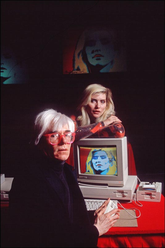 Andy Warhol with Debbie Harry and his Amiga Computer Portrait of Harry, NYC, 1985