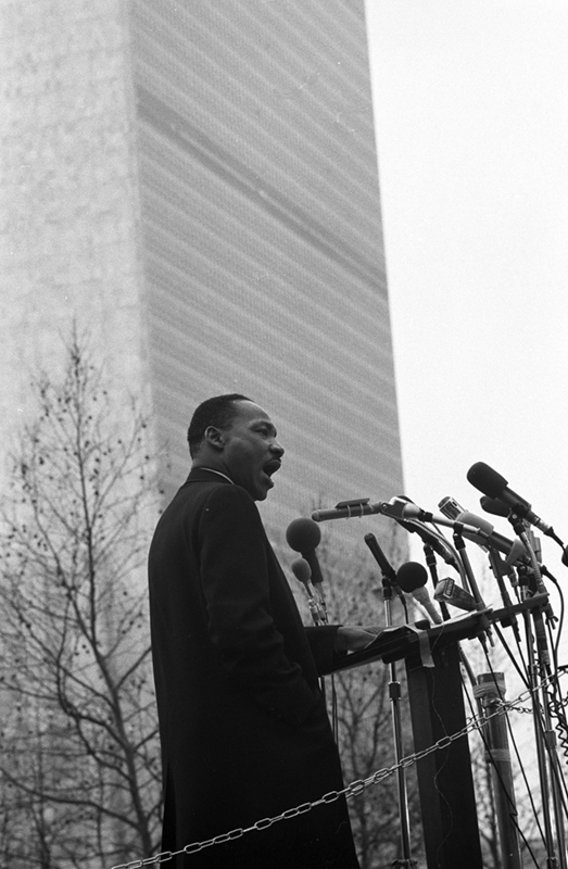 Martin Luther King Jr. at a Podium Speaking Outside UN, NYC, 1967
