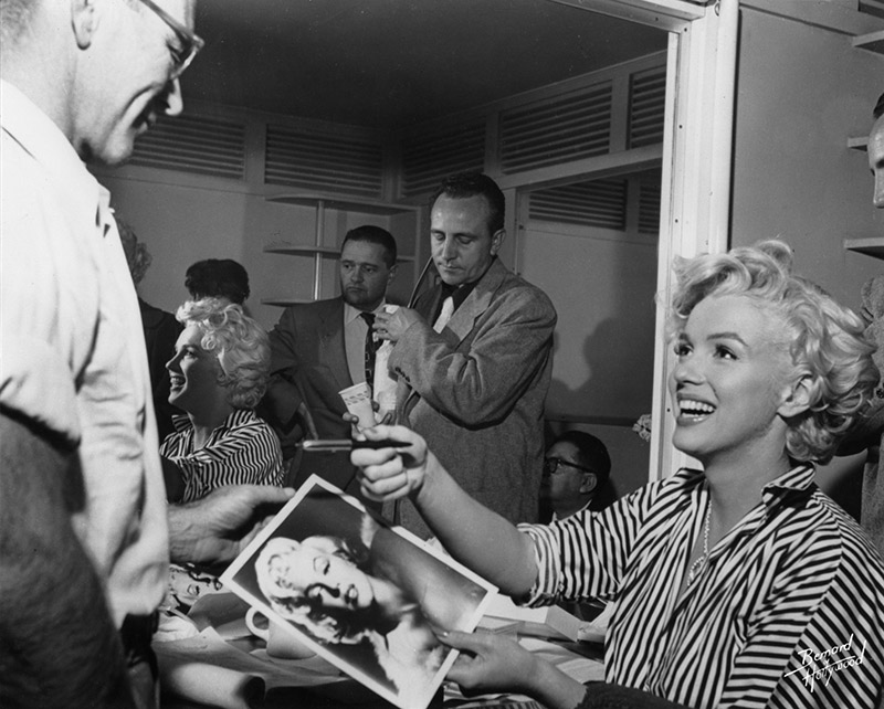 Marilyn Monroe, Signing Autographs in her Dressing Room, 1954